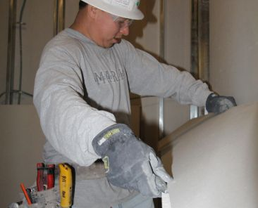 Jean Paul Maldonado with Ocean Drywall cuts a piece of drywall prior to putting it in place at the Langley Hospital on Joint Base Langley-Eustis. The hospital, which is being renovated by the U.S. Army Corps of Engineers' Little Rock District, will contain only 10 percent of the original construction; everything from exterior walls to flooring is being removed and replaced. (U.S. Army Photo/Patrick Bloodgood)